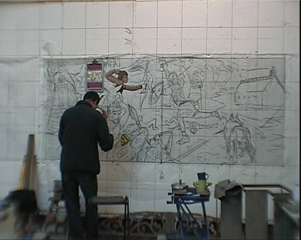 Village Mosaic - Oliver applying mosaic tiles